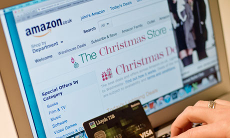 A woman using a card and shopping on Amazon